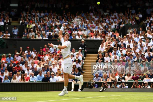 Andy Murray of Great Britain jumps for the ball during the Gentlemen's Singles first round match against Alexander Bublik of Kazakhstan on day one of...