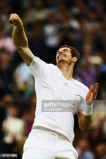 Andy Murray of Great Britain jumps in the air in celebration after winning his Gentlemen's Singles fourth round match against Kevin Anderson of South...