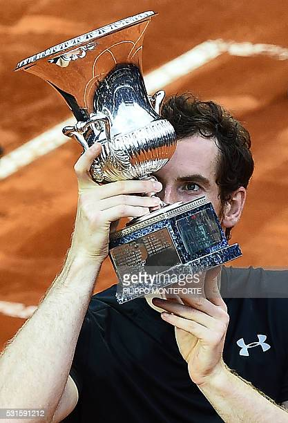 Andy Murray of Great Britain kisses the trophy after beating Serbia's Novak Djokovic in the final match of the ATP Tennis Open tournament game at the...
