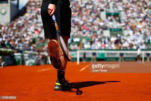 Andy Murray of Great Britain knocks clay from his shoes in his Men's Singles match against Jeremy Chardy of France on day nine of the 2015 French...