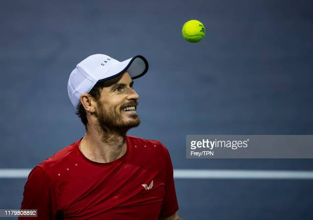 Andy Murray of Great Britain laughs while preparing to serve against Fabio Fognini of Italy in the second round of the Shanghai Rolex Masters at the...