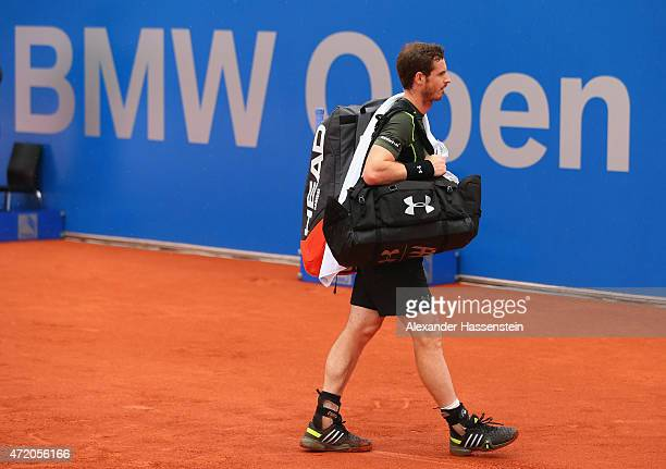 Andy Murray of Great Britain leaves the centre court during the second rain delay prior to the BMW Open final between Andy Murray of Great Britain...