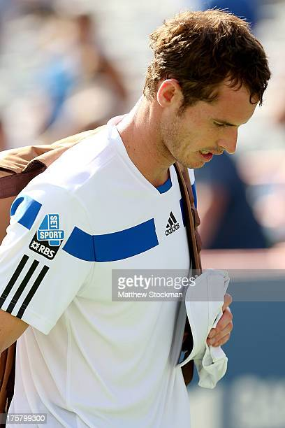 Andy Murray of Great Britain leaves the court after losing to Ernests Gulbis of Latvia during the Rogers Cup at Uniprix Stadium on August 8, 2013 in...