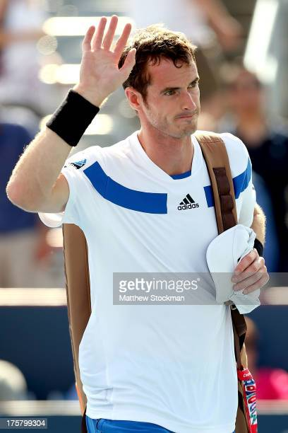 Andy Murray of Great Britain leaves the court after losing to Ernests Gulbis of Latvia during the Rogers Cup at Uniprix Stadium on August 8 2013 in...