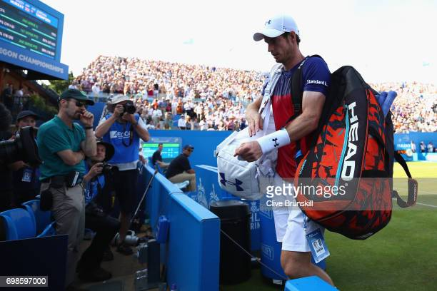 Andy Murray of Great Britain leaves the court following defeat in the mens singles first round match against Jordan Thompson of Australia on day two...