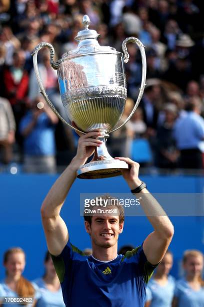 Andy Murray of Great Britain lifts the trophy after victory in the Men's Singles final against Marin Cilic of Croatia on day seven of the AEGON...