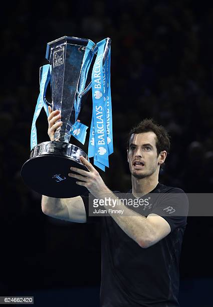 Andy Murray of Great Britain lifts the trophy following his victory during the Singles Final against Novak Djokovic of Serbia at the O2 Arena on...