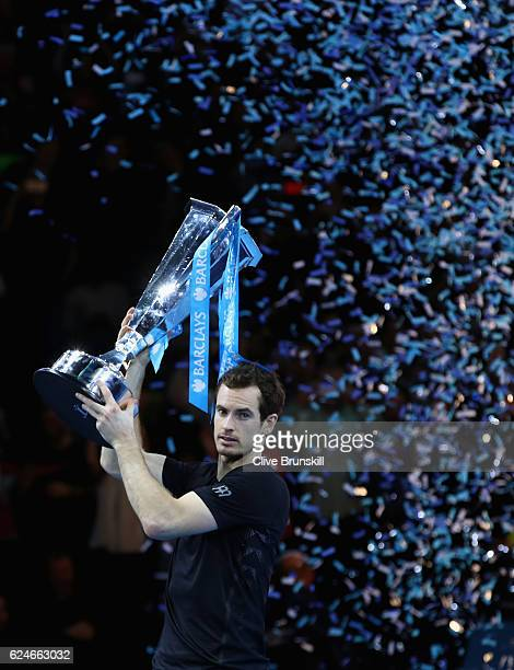 Andy Murray of Great Britain lifts the trophy following his victory during the Singles Final against Novak Djokovic of Serbia at the Barclays ATP...