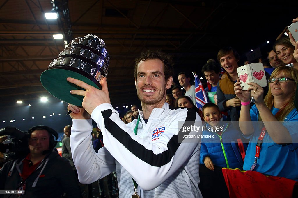 Andy Murray of Great Britain lifts the trophy following their victory during day three of the Davis Cup Final match between Belgium and Great Britain at Flanders Expo on November 29, 2015 in Ghent, Belgium.