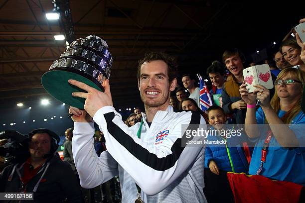 Andy Murray of Great Britain lifts the trophy following their victory during day three of the Davis Cup Final match between Belgium and Great Britain...