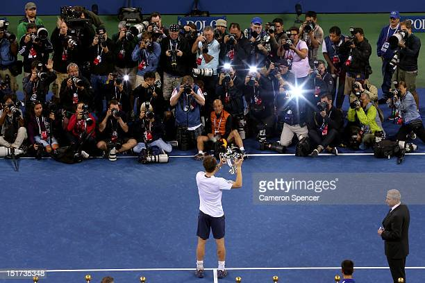 Andy Murray of Great Britain lifts the US Open championship trophy in front of photographers after defeating Novak Djokovic of Serbia in the men's...