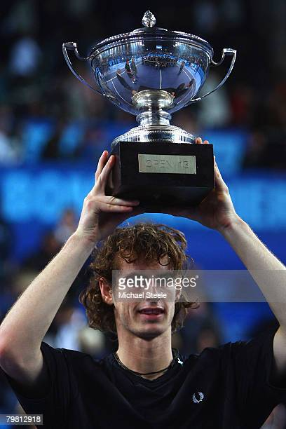 Andy Murray of Great Britain lifts the winners trophy after his 6-4, 6-3 victory in the final match against Mario Ancic of Croatia at the 2008 Open...