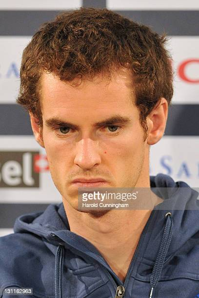 Andy Murray of Great Britain looks dejected as he announces his withdrawl from his firstround match due to injury during day three of the Swiss...