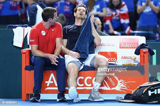Andy Murray of Great Britain looks exhausted following the singles match against Kei Nishikori of Japan on day three of the Davis Cup World Group...