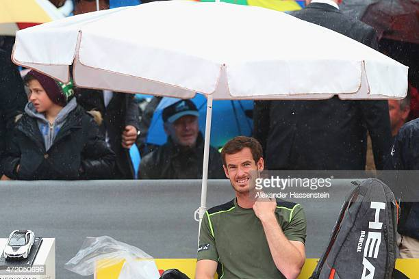 Andy Murray of Great Britain looks on from the centre court during a rain delay prior to the BMW Open final between Andy Murray of Great Britain and...