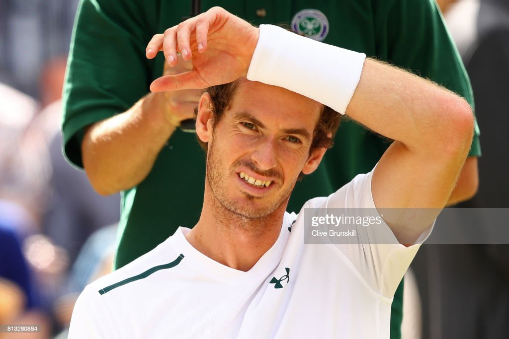 Andy Murray of Great Britain looks thoughtful as he takes a break during the Gentlemen's Singles quarter final match against Sam Querrey of The United States on day nine of the Wimbledon Lawn Tennis Championships at the All England Lawn Tennis and Croquet Club on July 12, 2017 in London, England.