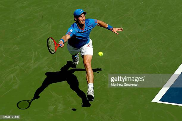 Andy Murray of Great Britain lunges for a shot while playing Sam Querrey during the Western Southern Open at the Lindner Family Tennis Center on...