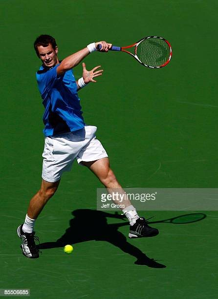 Andy Murray of Great Britain lunges to return a forehand to Ivan Ljubicic during the BNP Paribas Open at the Indian Wells Tennis Garden on March 19...