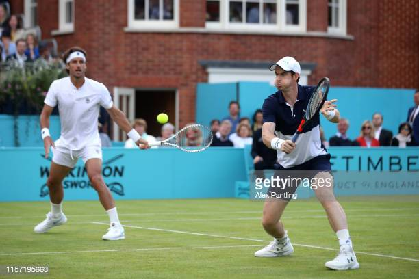 Andy Murray of Great Britain partner of Feliciano Lopez of Spain plays a backhand during his First Round Doubles match against Juan Sebastian Cabal...