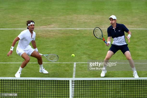 Andy Murray of Great Britain partner of Feliciano Lopez of Spain plays a forehand at the net during his First Round Doubles match against Juan...