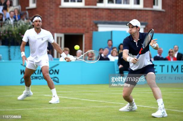Andy Murray of Great Britain partner of Feliciano Lopez of Spain plays a backhand during their mens doubles first round match against Juan Sebastian...