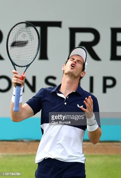 Andy Murray of Great Britain partner of Feliciano Lopez of Spain reacts during his First Round Doubles match against Juan Sebastian Cabal and Robert...
