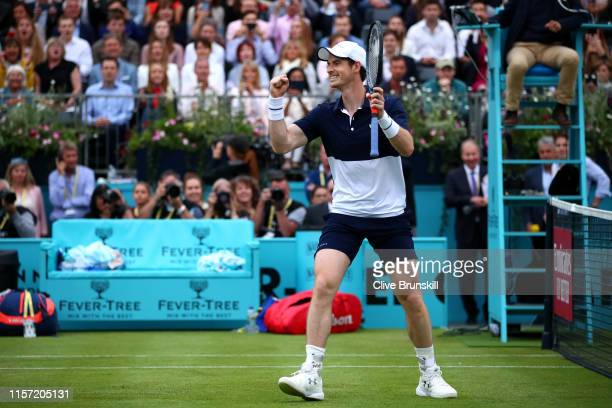 Andy Murray of Great Britain partner of Feliciano Lopez of Spain celebrates match point during his First Round Doubles match against Juan Sebastian...