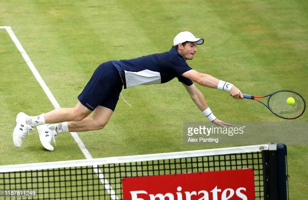 Andy Murray of Great Britain partner of Feliciano Lopez of Spain dives to return the ball in the mens doubles final against Rajeev Ram of The United...