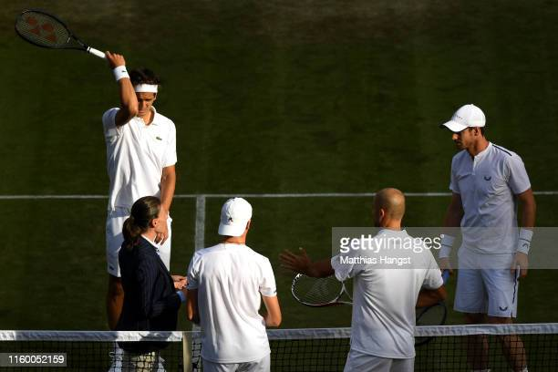 Andy Murray of Great Britain, partner of Pierre-Hughes Herbert of France and Marius Copil of Romania and Ugo Humbert of France speak with the umpire...
