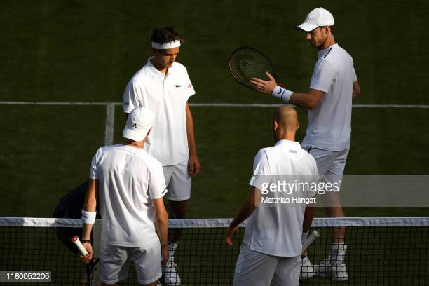 Andy Murray of Great Britain, partner of Pierre-Hughes Herbert of France and Marius Copil of Romania and Ugo Humbert of France speak at the net prior...