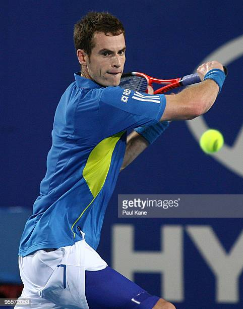 Andy Murray of Great Britain plays a back hand shot to Andrey Golubev of Kazakhstan in the Group B match between Great Britain and Kazakhstan during...