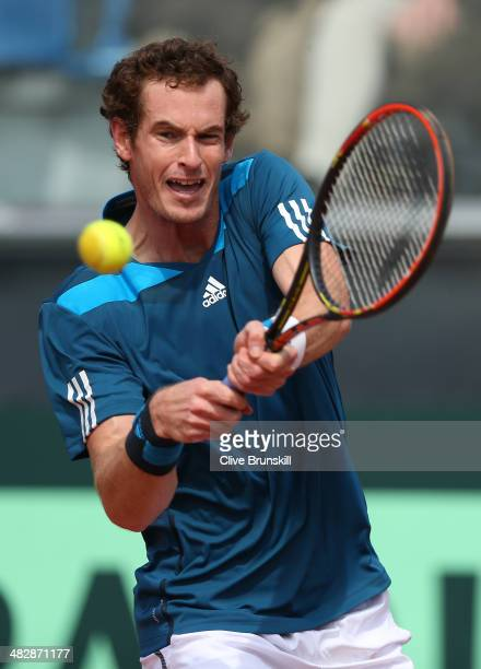 Andy Murray of Great Britain plays a backhand against Andreas Seppi of Italy during day two of the Davis Cup World Group Quarter Final match between...
