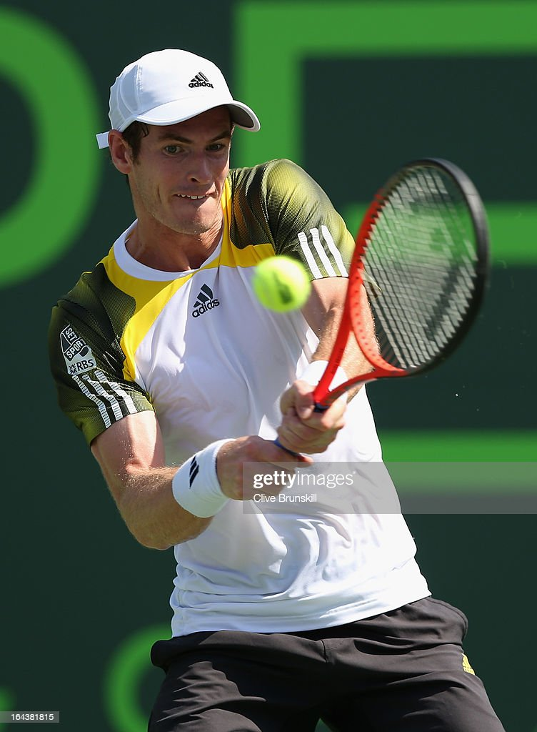 Andy Murray of Great Britain plays a backhand against Bernard Tomic of Australia during their second round match at the Sony Open at Crandon Park Tennis Center on March 23, 2013 in Key Biscayne, Florida.