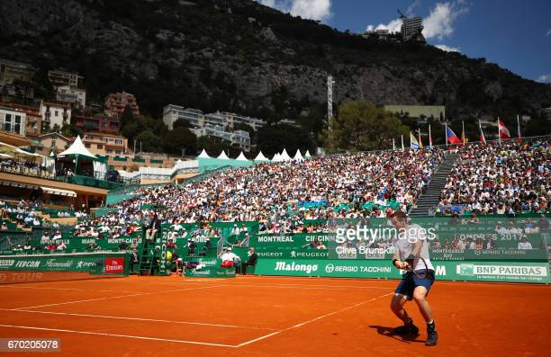 Andy Murray of Great Britain plays a backhand against Gilles Muller of Luxembourg in his second round match on day four of the Monte Carlo Rolex...