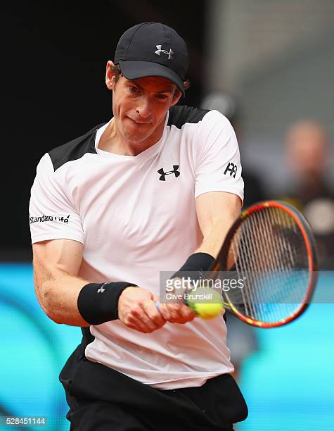 Andy Murray of Great Britain plays a backhand against Gilles Simon of France in their third round match during day six of the Mutua Madrid Open...