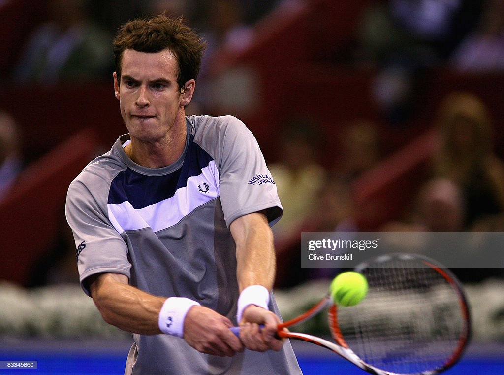 Andy Murray of Great Britain plays a backhand against Gilles Simon of France during the final at the Madrid Masters tennis tournament at the Madrid Arena on October 19, 2008 in Madrid, Spain.