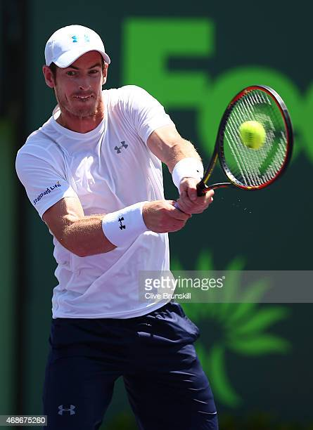 Andy Murray of Great Britain plays a backhand against Novak Djokovic of Serbia in the mens final during the Miami Open Presented by Itau at Crandon...