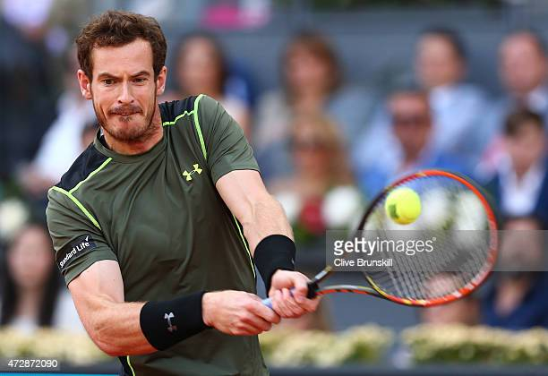 Andy Murray of Great Britain plays a backhand against Rafael Nadal of Spain in the mens final during day nine of the Mutua Madrid Open tennis...