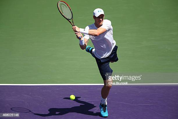 Andy Murray of Great Britain plays a backhand against Santiago Giraldo of Columbia in their third round match during the Miami Open Presented by Itau...