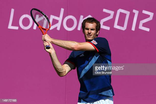 Andy Murray of Great Britain plays a backhand during a practice session ahead of the 2012 London Olympic Games at the All England Lawn Tennis and...