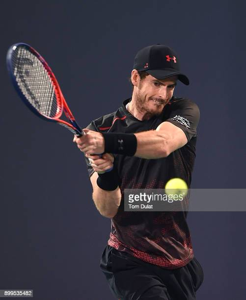 Andy Murray of Great Britain plays a backhand during his exhibition match against Roberto Bautista Agut of Spain on day two of the Mubadala World...