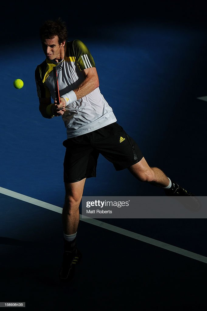 Andy Murray of Great Britain plays a backhand during his match against Denis Istomin of Uzbekistan on day six of the Brisbane International at Pat Rafter Arena on January 4, 2013 in Brisbane, Australia.