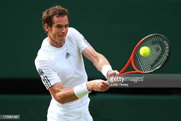 Andy Murray of Great Britain plays a backhand during the Gentlemen's Singles fourth round match against Mikhail Youzhny of Russia on day seven of the...
