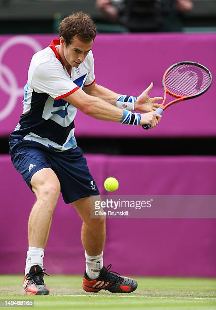 Andy Murray of Great Britain plays a backhand during the Men's Singles Tennis match against Stanislas Wawrinka of Switzerland on Day 2 of the London...