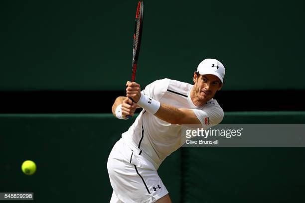 Andy Murray of Great Britain plays a backhand during the Men's Singles Final against Milos Raonic of Canada on day thirteen of the Wimbledon Lawn...