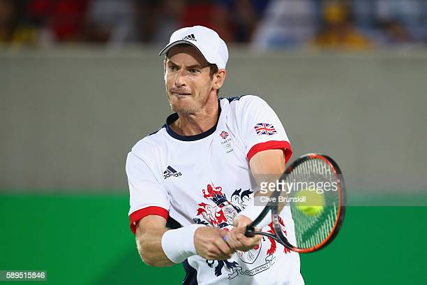 Andy Murray of Great Britain plays a backhand during the men's singles gold medal match against Juan Martin Del Potro of Argentina on Day 9 of the...