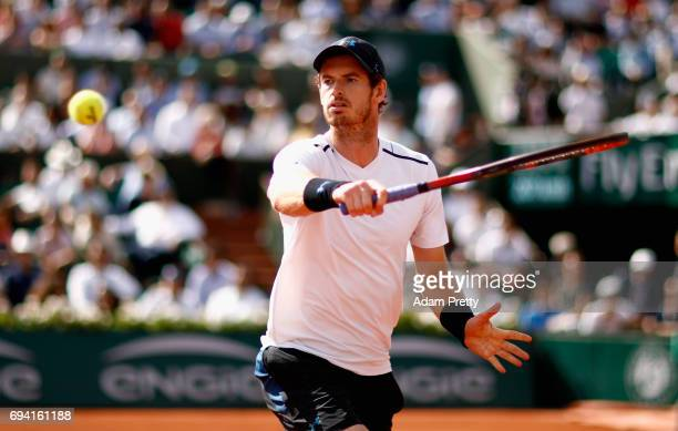 Andy Murray of Great Britain plays a backhand during the mens singles semifinal match against Stan Wawrinka of Switzerland on day thirteen of the...