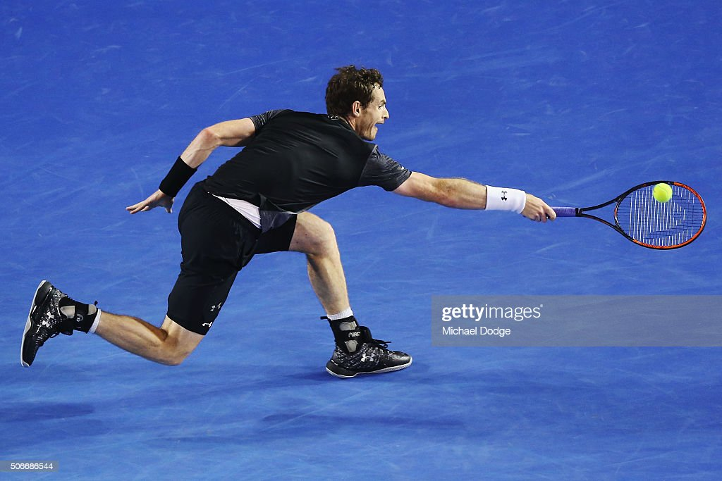 Andy Murray of Great Britain plays a backhand in his fourth round match against Bernard Tomic of Australia during day eight of the 2016 Australian Open at Melbourne Park on January 25, 2016 in Melbourne, Australia.