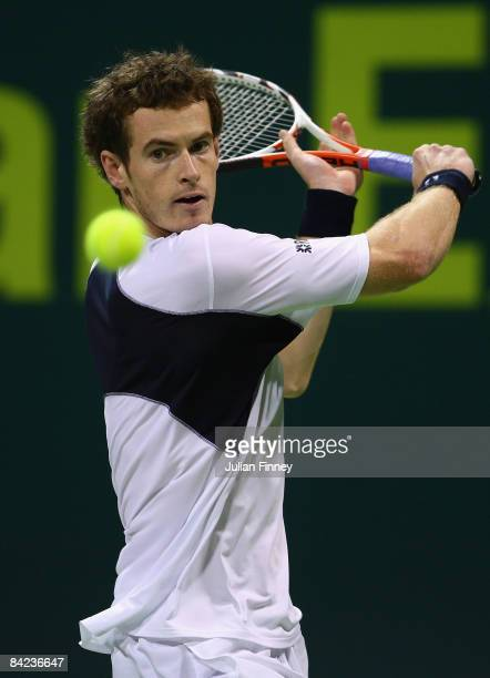 Andy Murray of Great Britain plays a backhand in his match against Andy Roddick of United States during the Exxon Mobil Qatar Open Tennis on January...