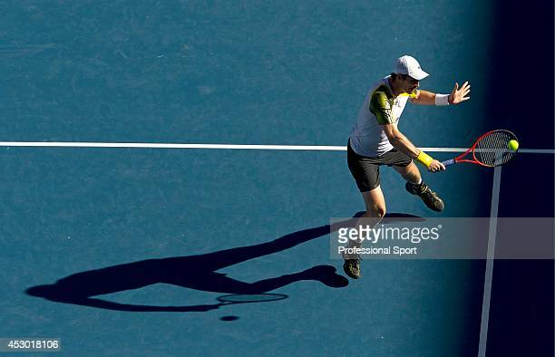 Andy Murray of Great Britain plays a backhand in his Quarterfinal match against Jeremy Chardy of France during day ten of the 2013 Australian Open at...